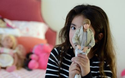 Vivian, 7, is photographed with her favorite Justin Bieber doll in her Orinda, Calif., bedroom