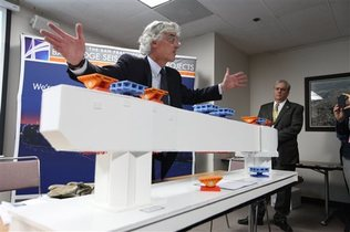 Bridge engineer Brian Maroney uses a model to explain the broken rod issue on the new span of the Bay Bridge
