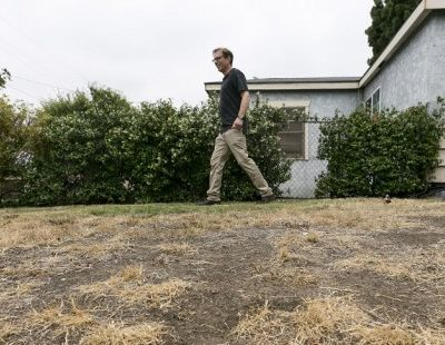 Michael Korte walks across his lawn in Glendora