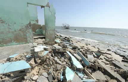 A house on the beach of Doun Baba Dieye, northern Senegal, lies in ruins after sea level rise