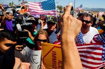 Demonstrators picketing against the arrival of undocumented migrants who were scheduled to be processed at the Murrieta Border Patrol Station