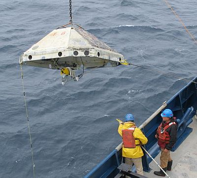 Researchers retrieve an ocean-bottom seismometer off the coast of Oregon