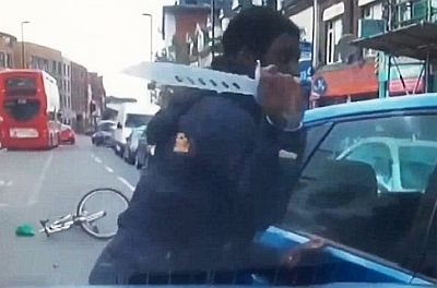 the horrifying moment the young man sprinted after a Volkswagen Polo on a busy high street in Croydon before trying to break through the driver's side window in a frenzied attack