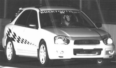 The driver of this Subaru belonging to Dave VonTesmar wears a monkey mask